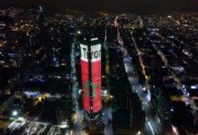 Photo of Bogotá (Colombia):  La Torre Colpatria se viste de colores marroquies para celebrar la Fiesta del Trono